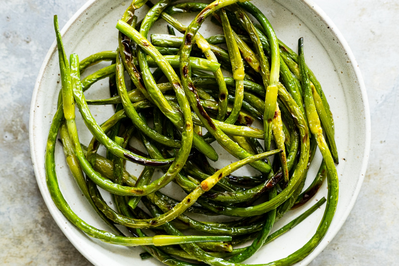 charred grilled garlic scapes