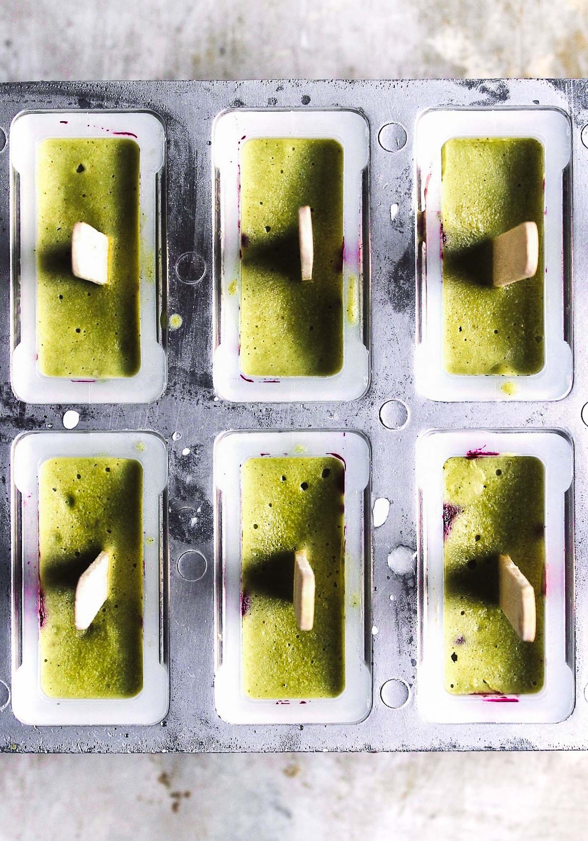 matcha popsicles in popsicle mold