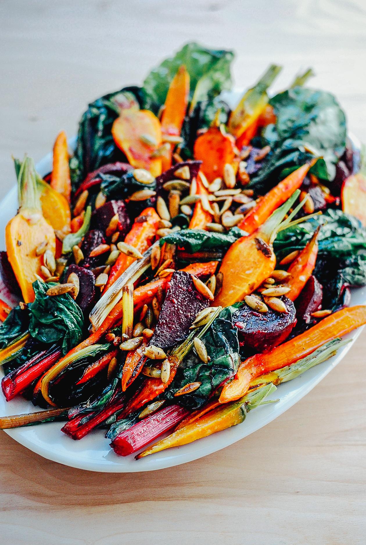 Roasted Vegetable Salad with Garlic Dressing + Toasted Pepitas | A simple and hearty roasted vegetable salad tossed in a garlic dressing and topped with toasted pepitas. A roasted vegetable salad for fall or all seasons.