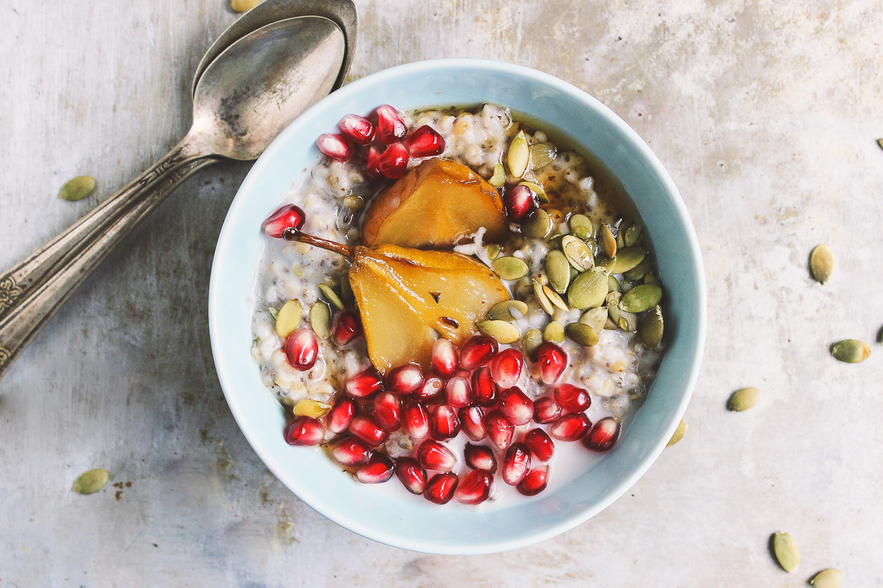 Super Seed Steel Cut Oats with Maple Roasted Pears + Pomegranate | Super seed steel cut oats packed with chia and flax and lightly sweetened with maple roasted pears. Oats can be made ahead of time to have on hand all week.