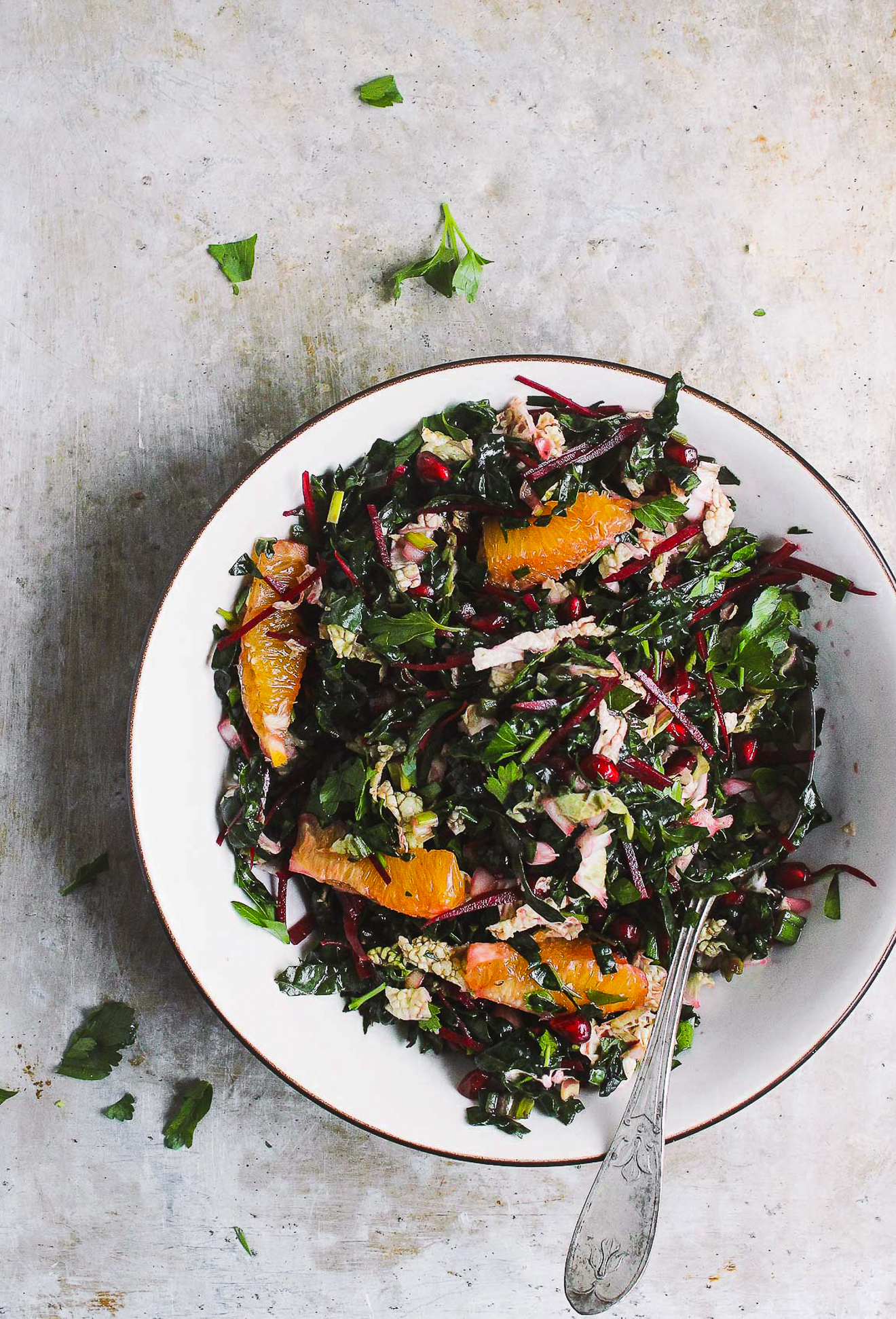 Winter Chopped Kale Salad with Citrus Vinaigrette | Winter chopped kale salad packed with pomegranates and oranges and a zesty citrusy vinaigrette. A hearty, naturally vegan and gluten-free winter kale salad.