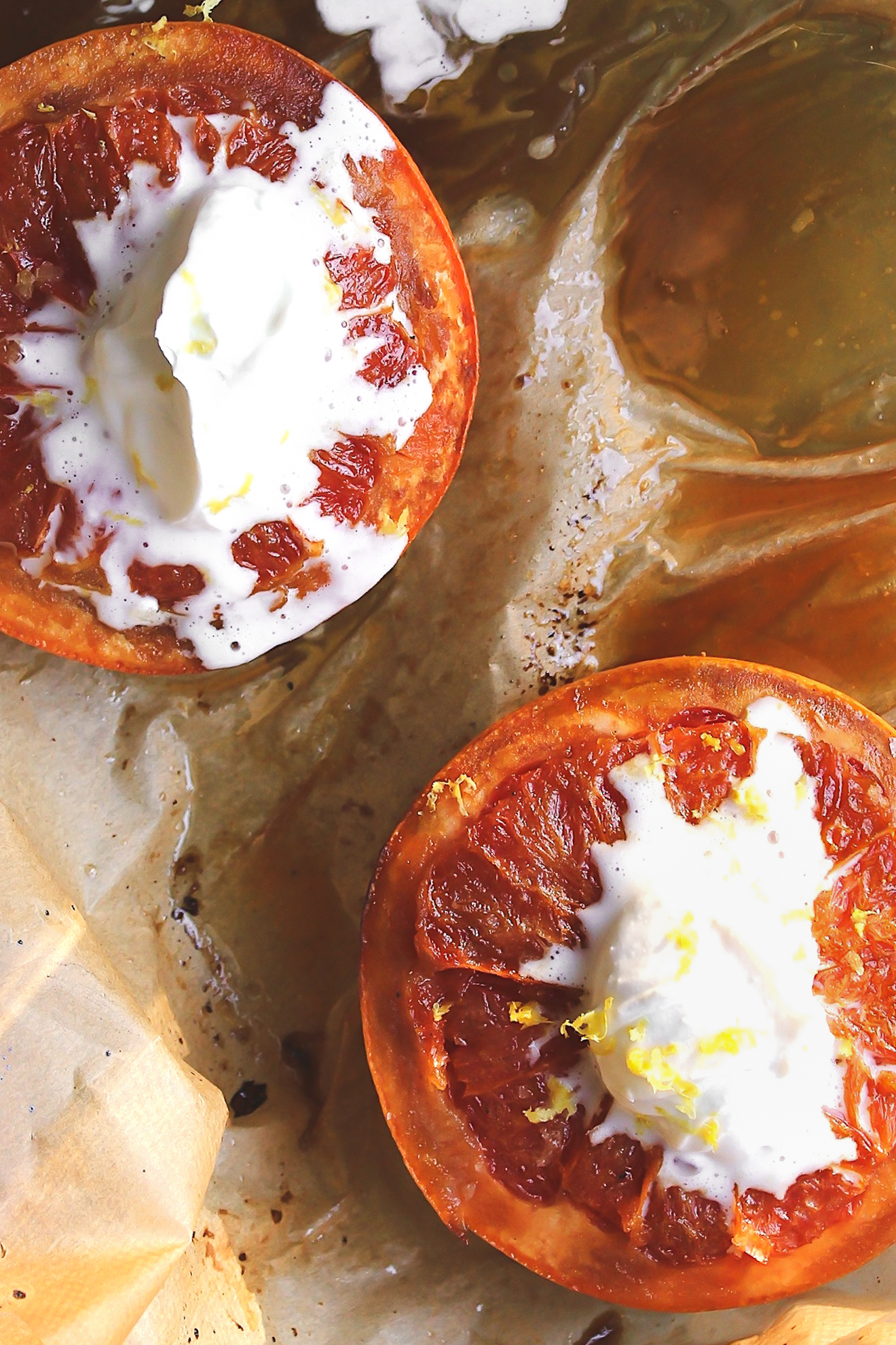 Broiled Grapefruit with Vanilla Ginger Coconut Cream + Sea Salt | A sweet and salty, maple broiled grapefruit with vegan coconut cream and a touch of sea salt. A beautiful, wintry, unfussy, baked grapefruit dessert. #broiledgraperfruit #bakedgrapefruit
