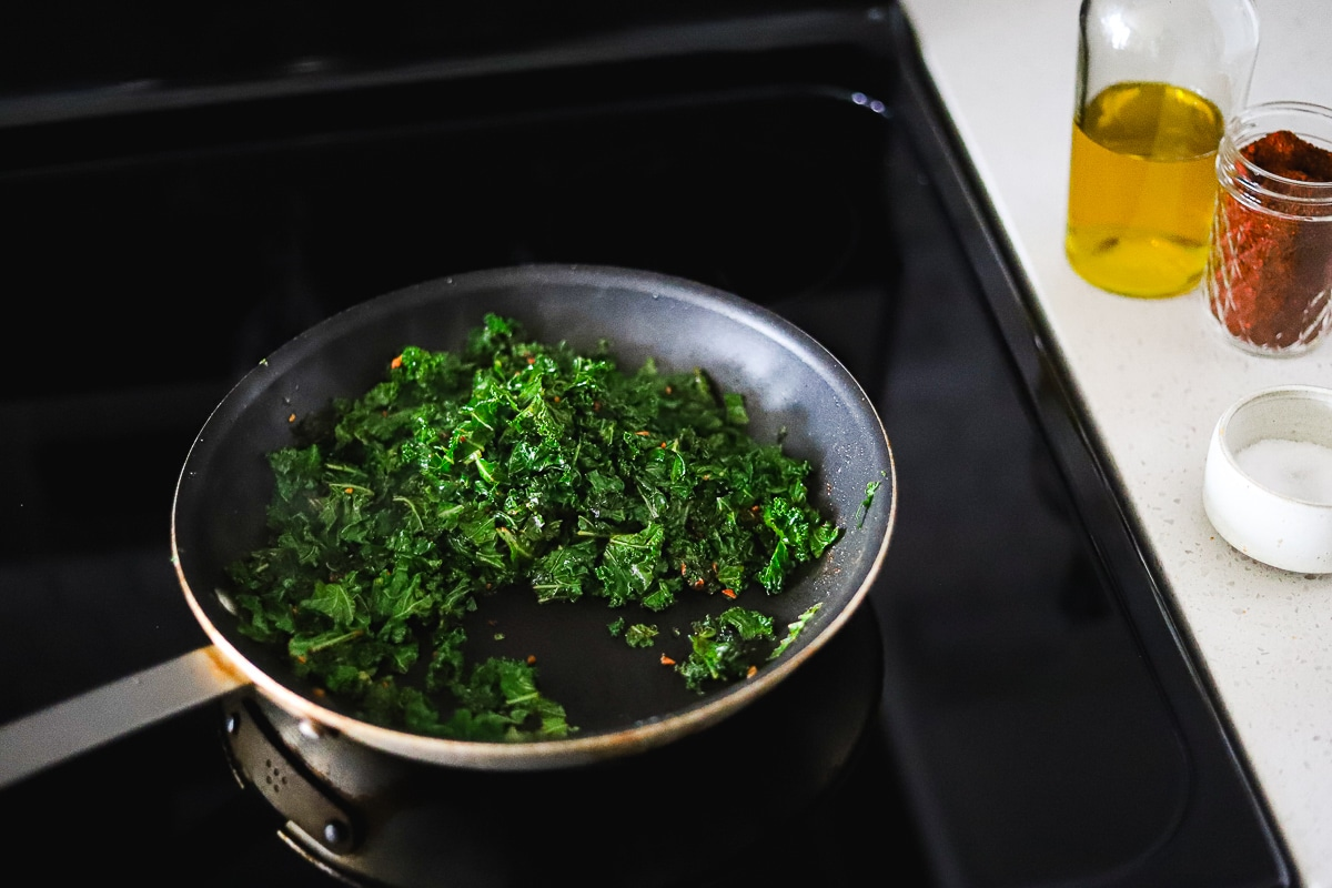kale simmering in a pan