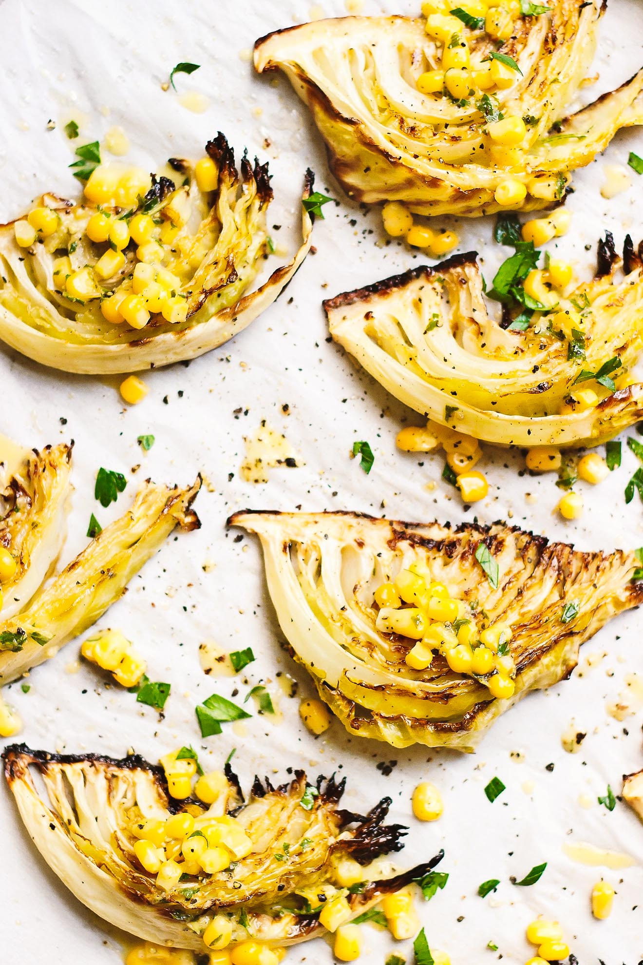 Roasted Cabbage with Sweet Corn + Spicy Vinaigrette | Roasted cabbage wedges with sweet corn and a roasted, spicy vinaigrette is an easy, satisfying summery meal. Naturally gluten-free and vegan.