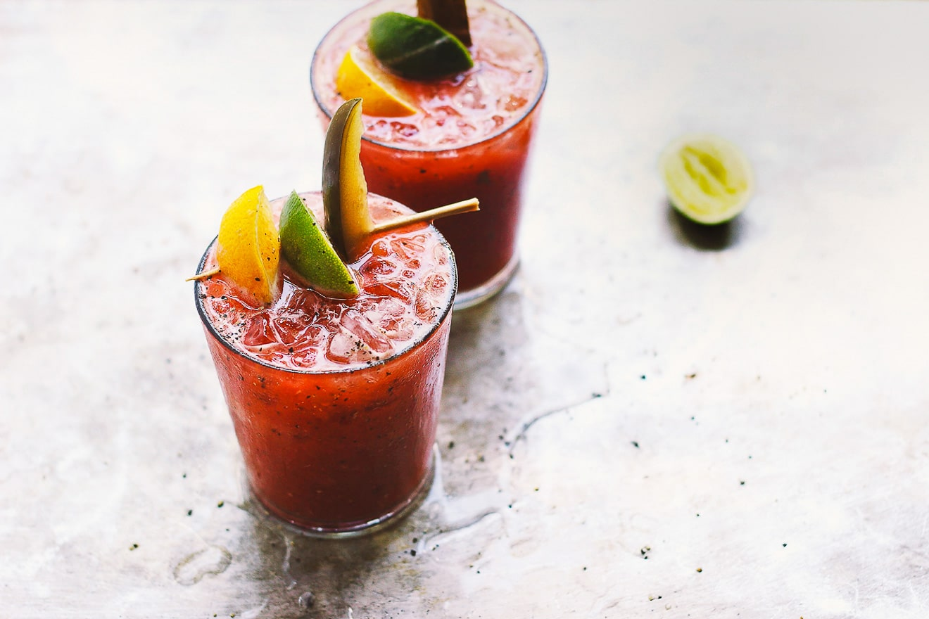 Fresh Bloody Marys with Old Bay + Spicy Pickles | Fresh Bloody Mary mix made with fresh heirloom tomatoes and with a touch of Old Bay seasoning. The best way to preserve summer tomatoes and have fresh Bloody Mary mix cocktails all year round.