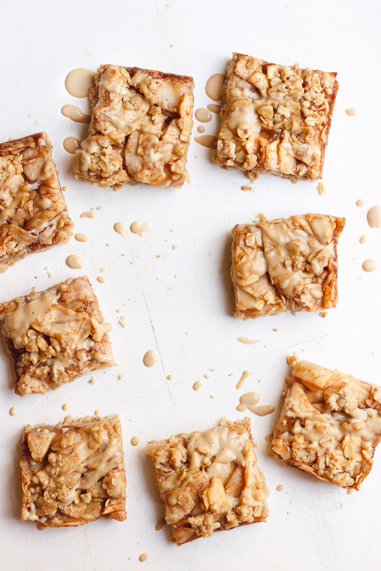 Apple Crumb Bars with Maple Coffee Glaze | These maple-sweetened, gluten-free and naturally vegan, oat apple crumb bars are fancied up with a light drizzle of a maple coffee glaze.