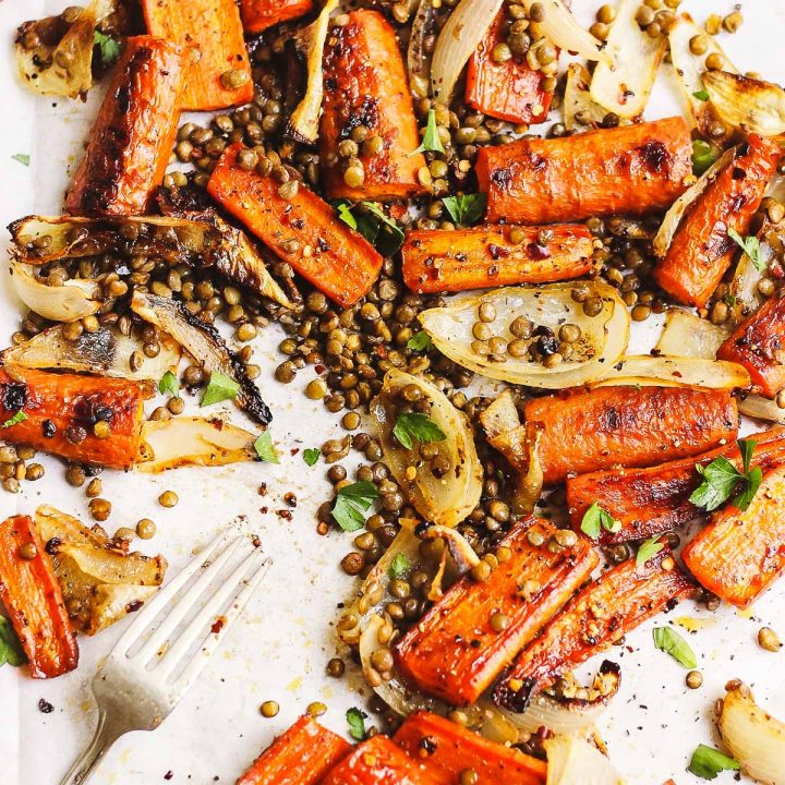 maple roasted carrots with lentils and onions on a sheet pan
