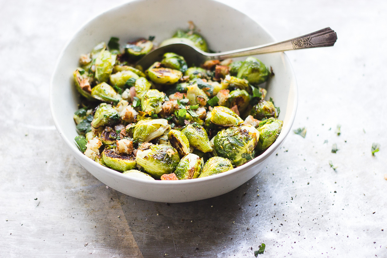 brussels sprouts with bread crumbs in a bowl with a spoon