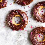 vanilla donuts with chocolate frosting and rose petals