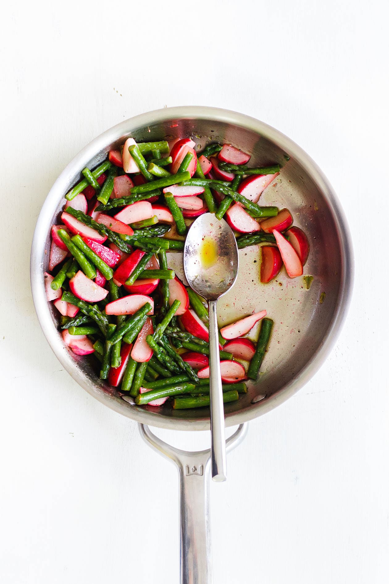 asparagus and radishes in a saute pan