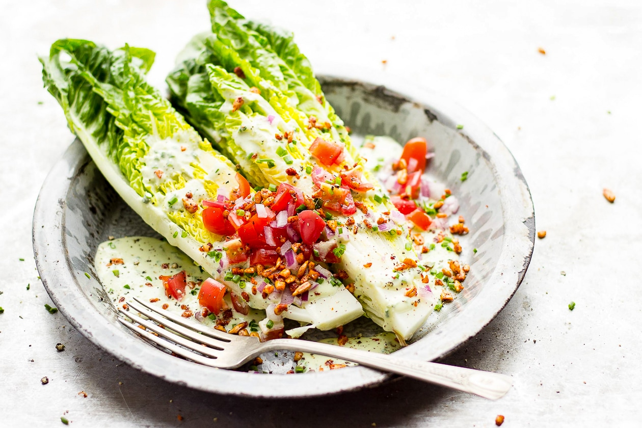Romaine Wedge Salad with Chive Dressing + Smoky Sunflower Bits | A vegan romaine wedge salad that is topped with raw, creamy chive dressing and smoky sunflower vegan bacon bits. Summery food at its finest.