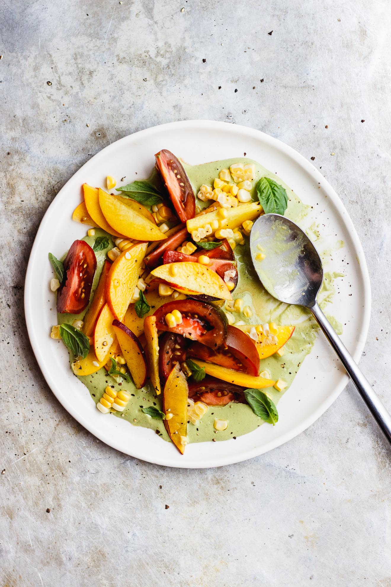 basil sauce and tomato peach salad
