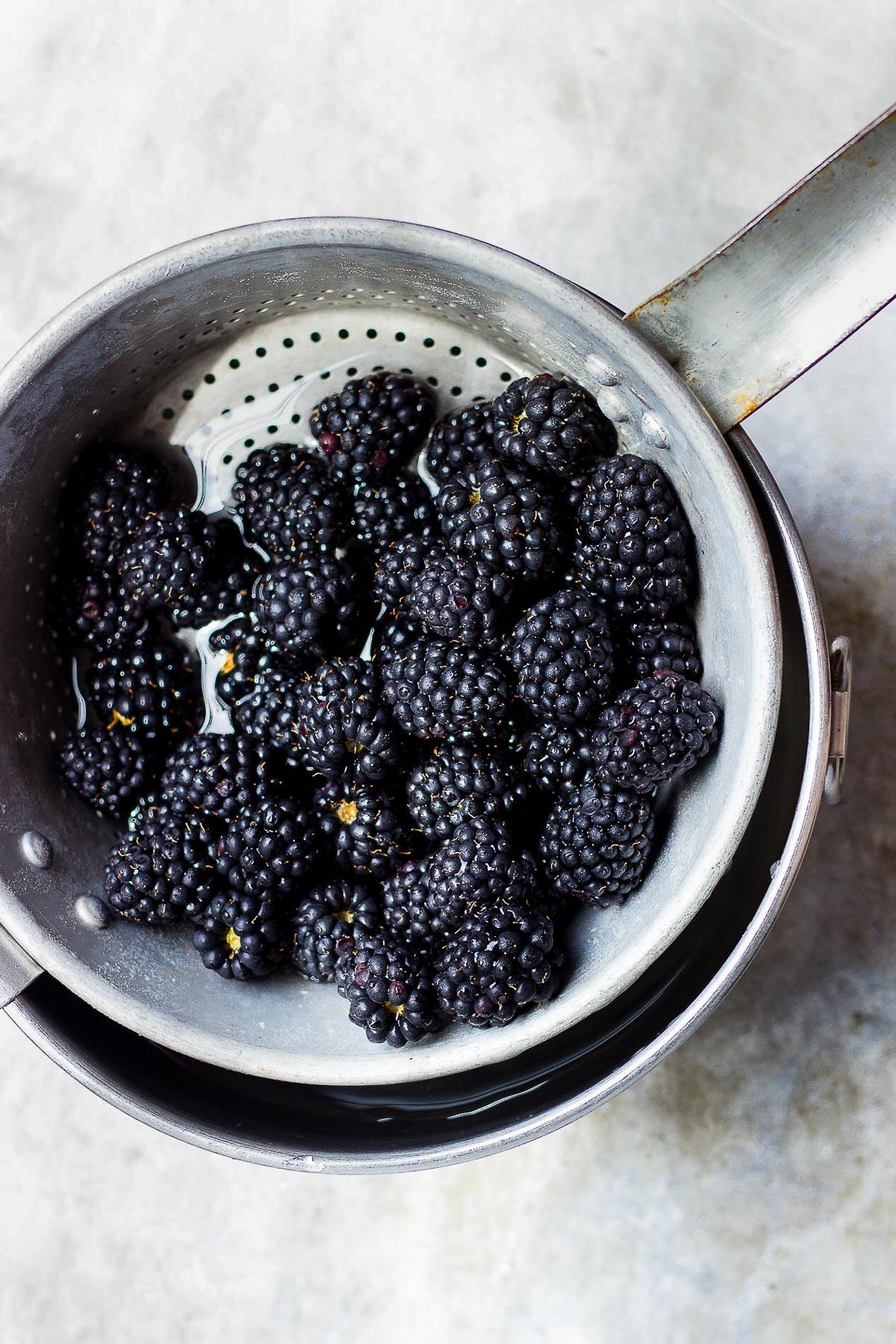 blackberries in a colander
