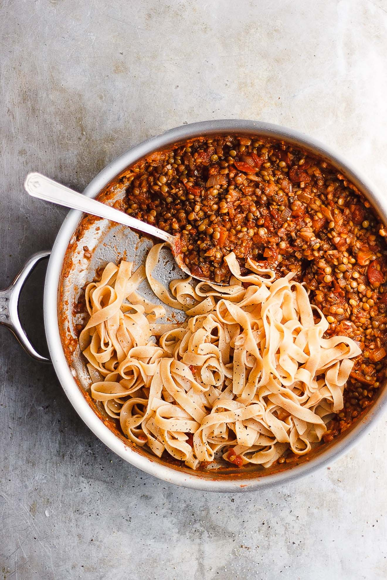 lentil bolognese sauce with tagliatelle in a pan