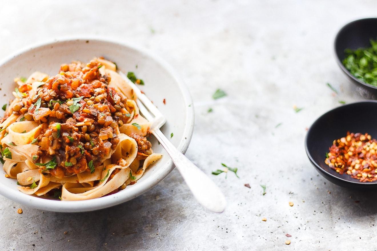 lentil bolognese sauce over pasta