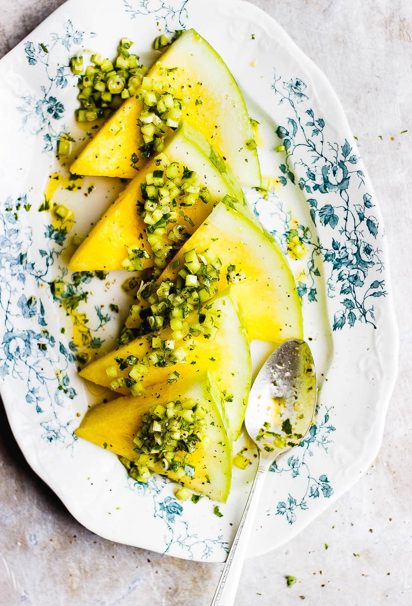 Yellow Watermelon Salad with Herby Cucumber Relish | Small diced cucumbers with fresh herbs and lots of olive oil and apple cider vinegar over a wedge of yellow watermelon for an easy yellow watermelon salad.