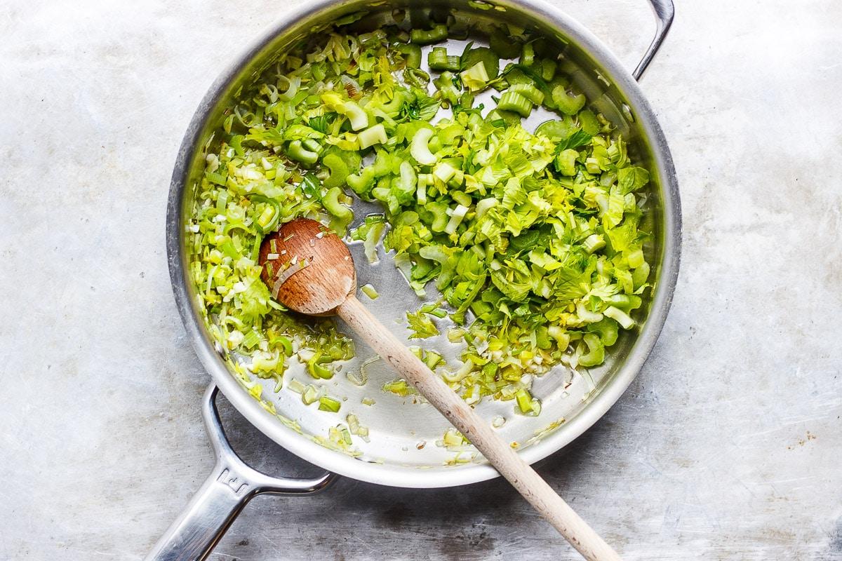 diced celery sautéing in a pan