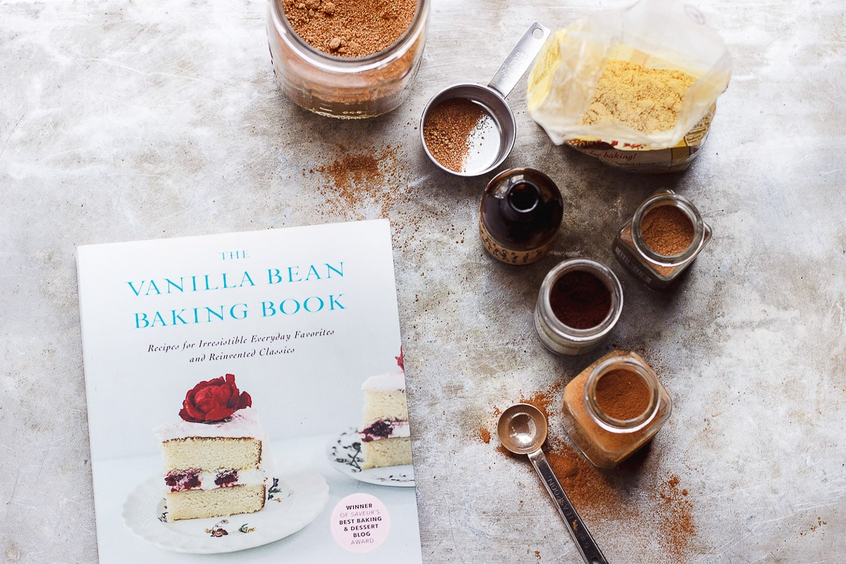 Vanilla Bean Baking Book on counter with spices