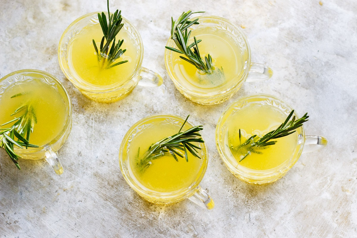 winter champagne punch with rosemary sprigs
