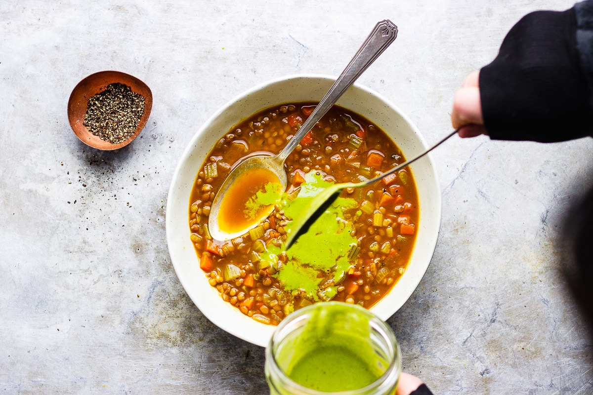 sauce on top of vegan lentil soup