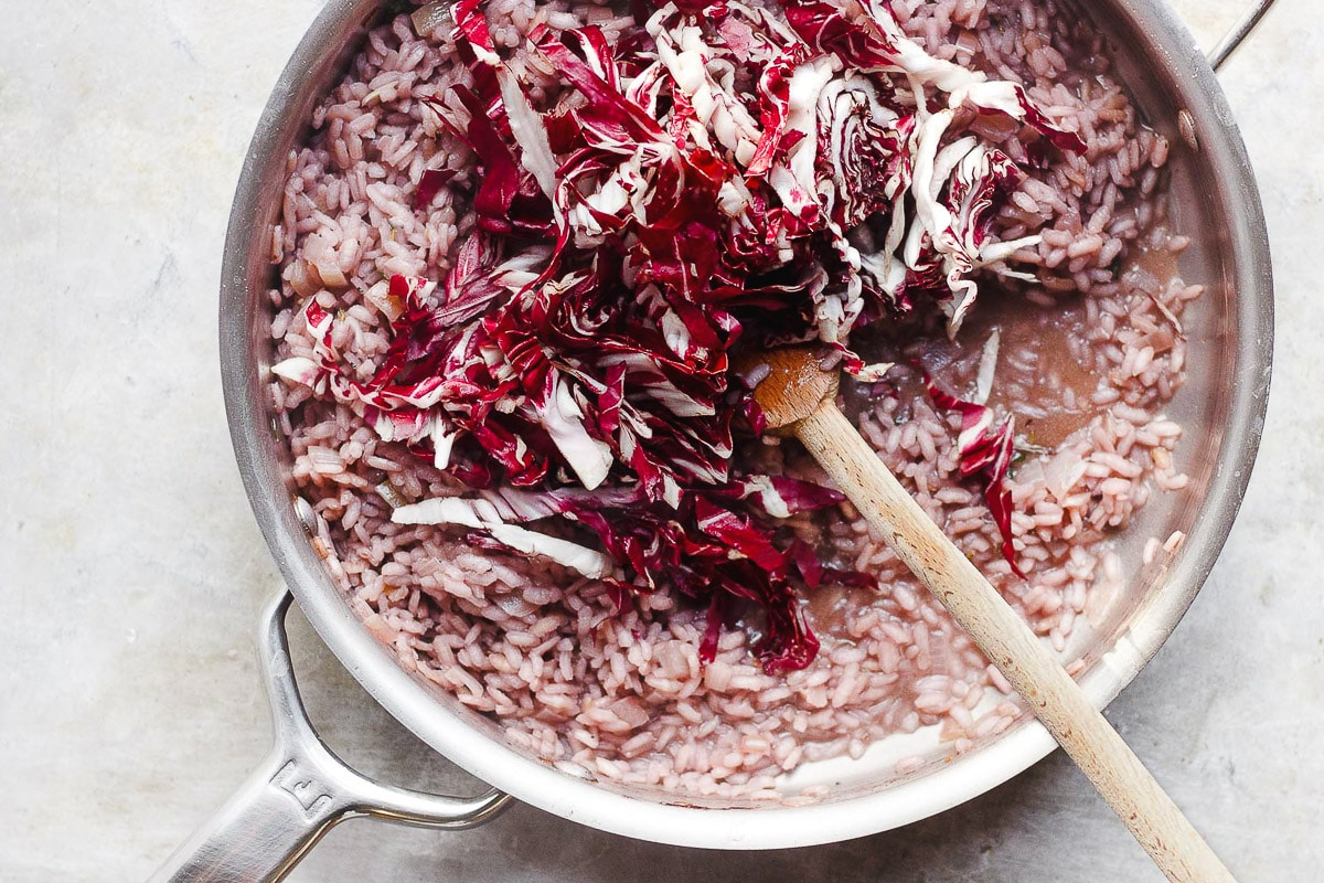 radicchio risotto in pan with spoon