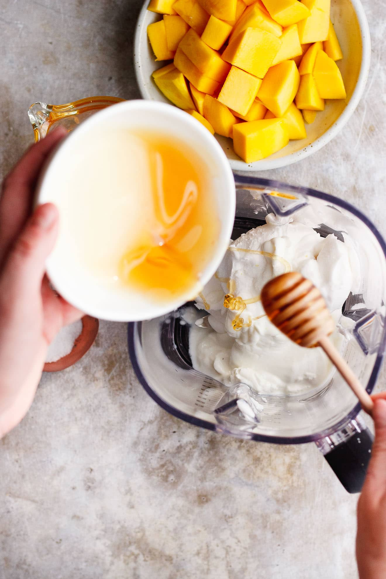 Coconut Mango Milkshake with Honey + Chamomile | A smooth, creamy coconut mango milkshake made from coconut cream and naturally vegan. Infused with chamomile tea and drizzled with honey.