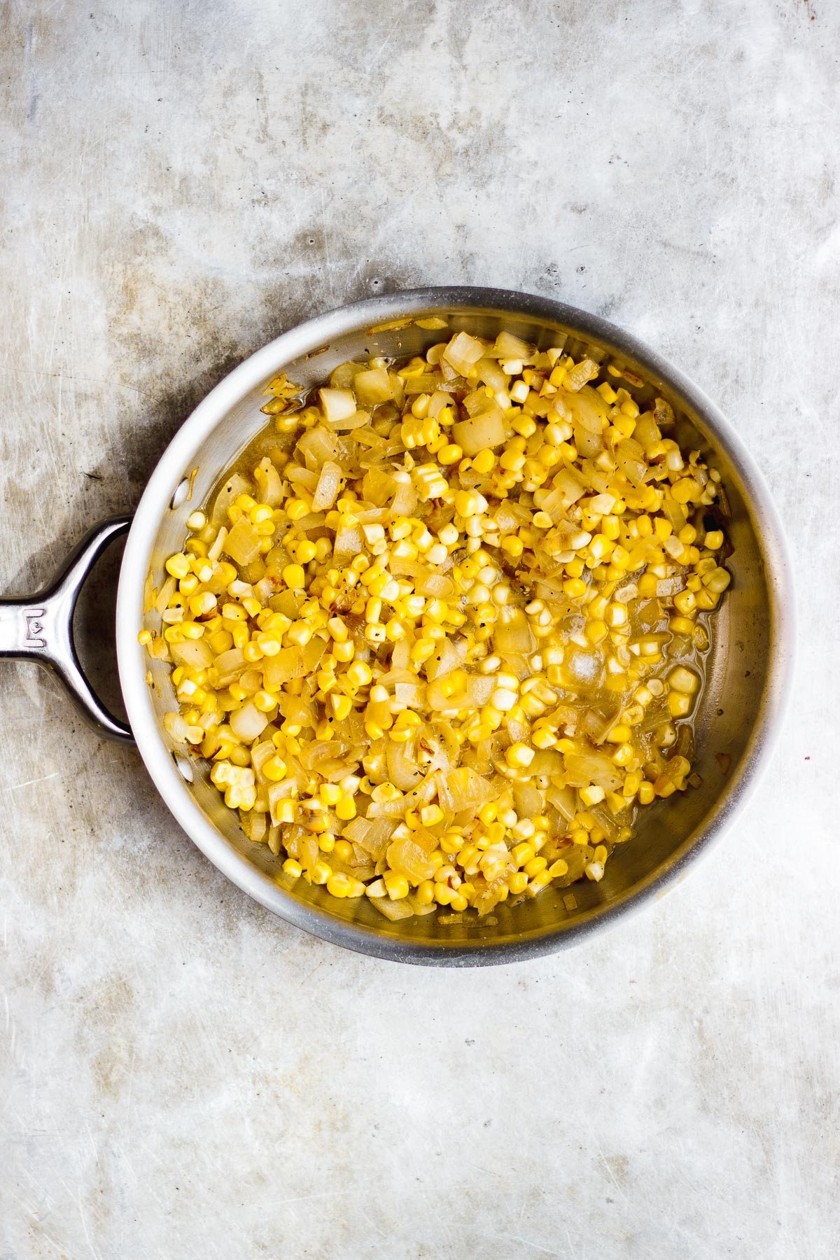 corn and onion in a skillet