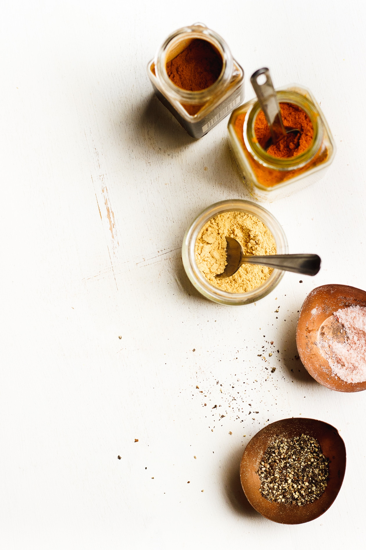 spices in jars on white background
