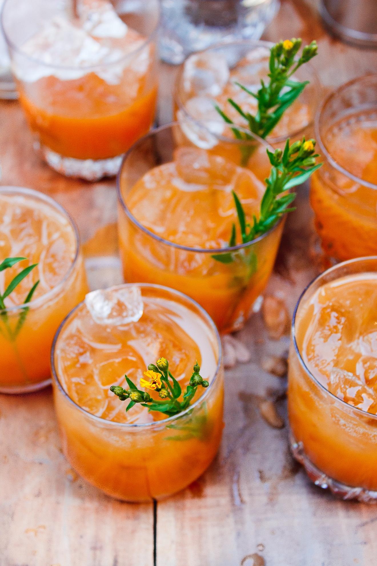 carrot shrub cocktail with fresh tarragon