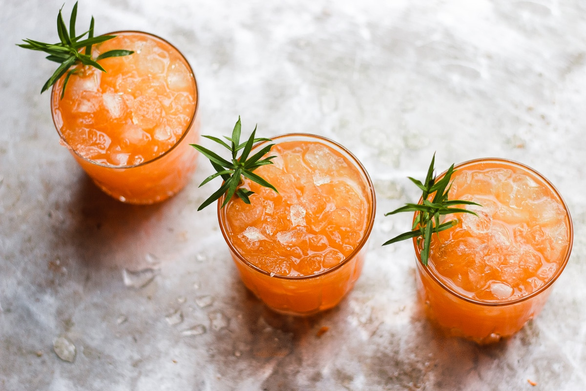 carrot shrub cocktail with tarragon