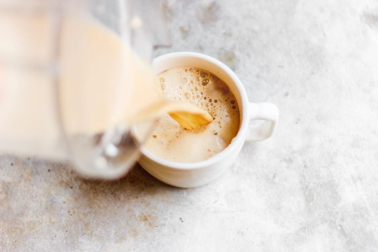 pouring bulletproof tea in mug