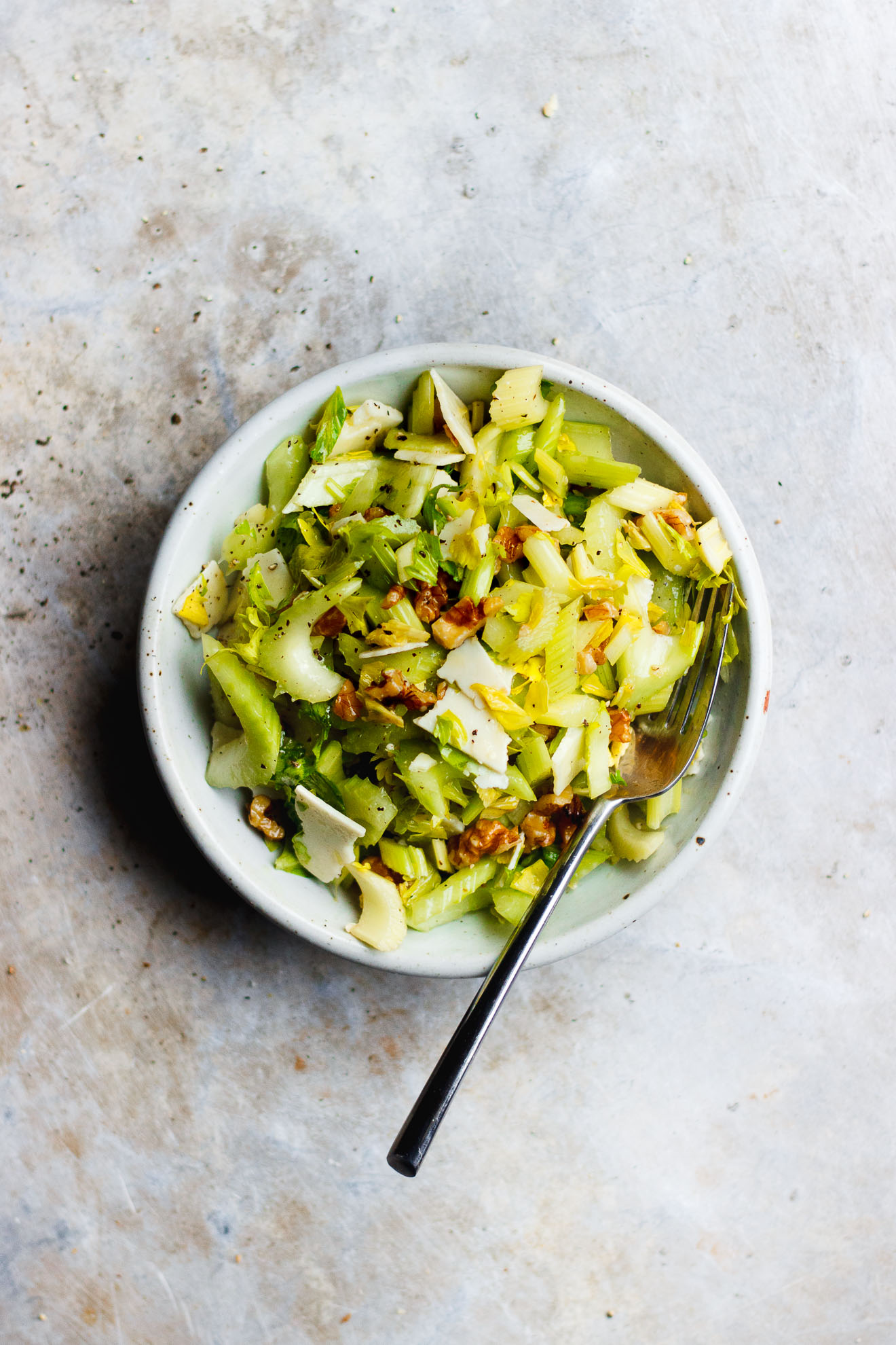 Celery Salad with Parmigiano-Reggiano + Walnuts | A salty, crunchy celery salad with parmigiano-reggiano and walnuts. A classic, three-ingredient celery and parmesan cheese salad.