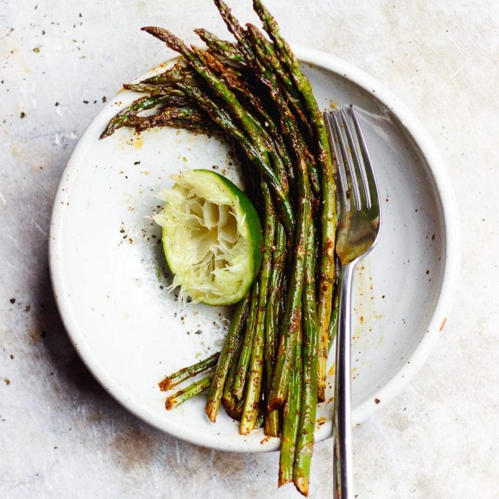 mexican asparagus in a bowl with lime