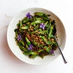 asparagus lentils and edible flower salad in a bowl