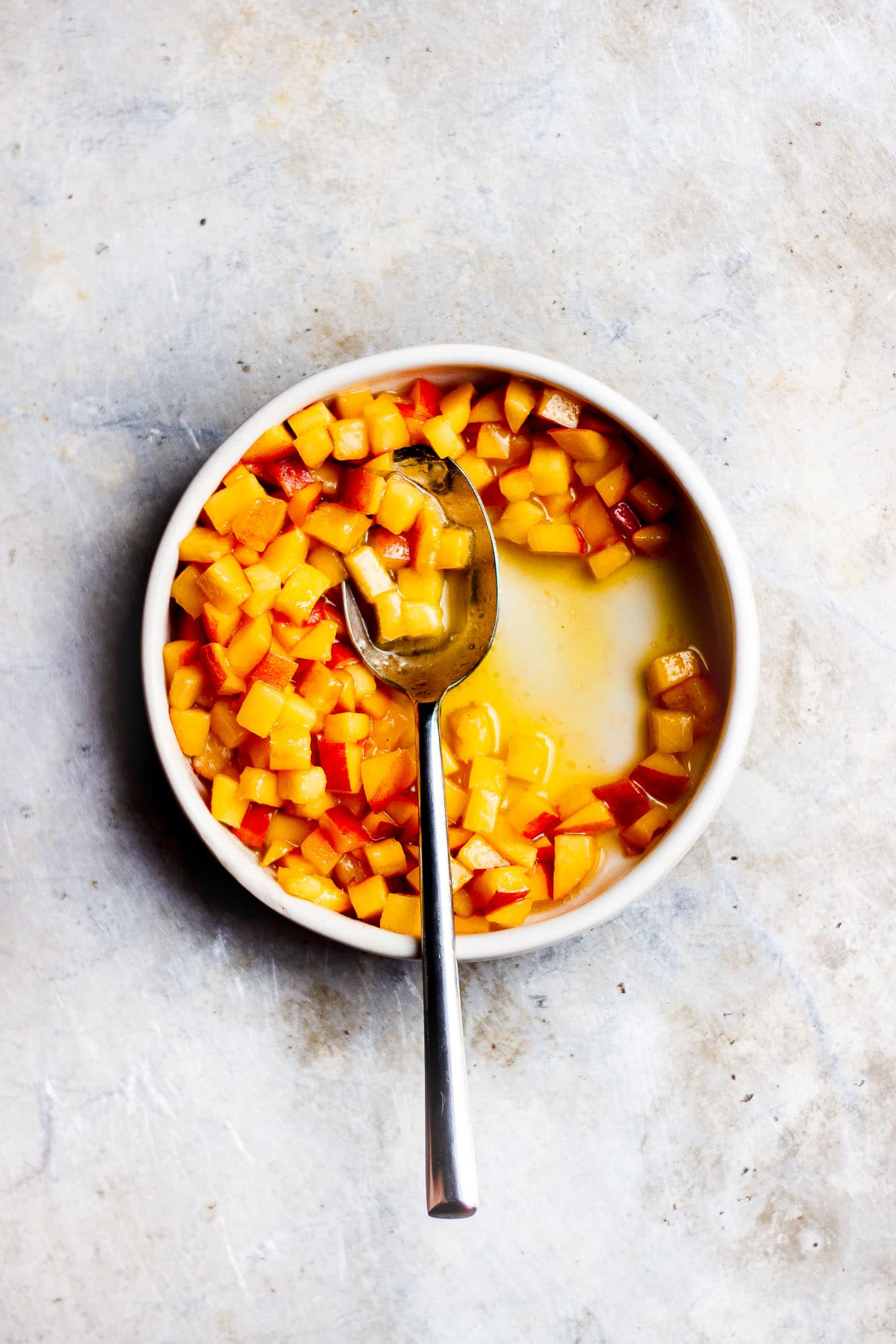 salty peaches in a bowl