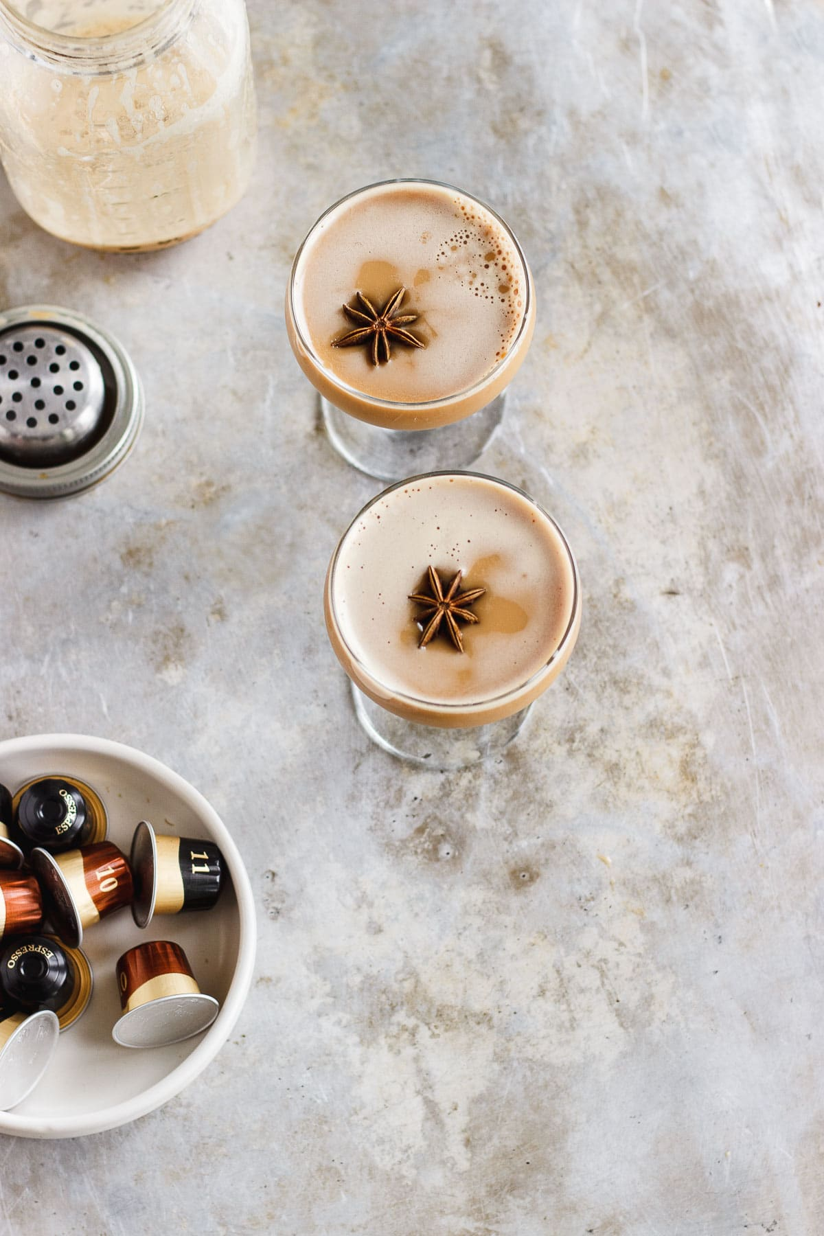 A dirty chai martini naturally sweetened with maple and balanced with a pinch of pink Himalayan salt. Made creamy with almond milk for a vegan cocktail. #dirtychaimartini #dirtychai #espressomartini