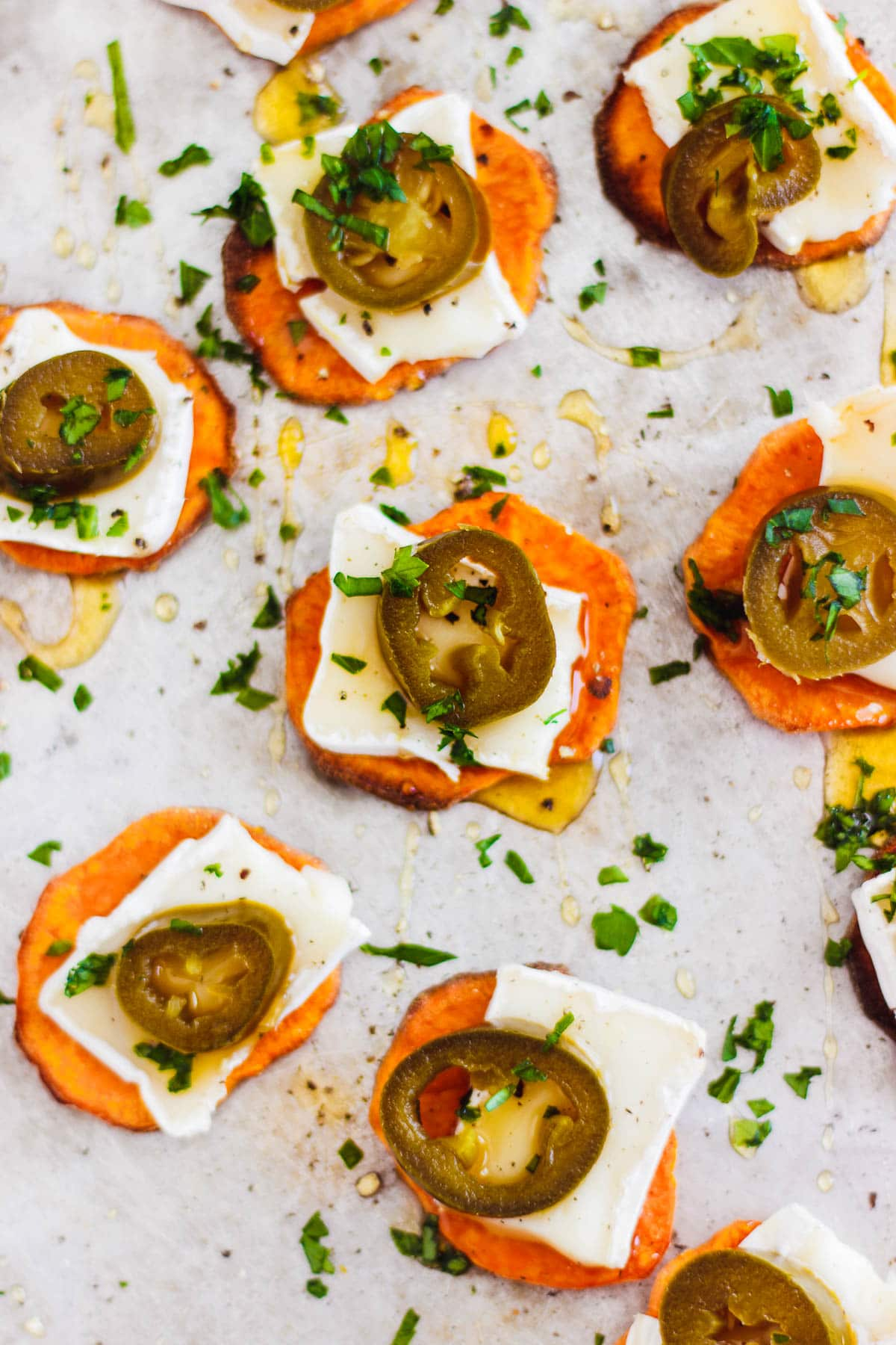 These sweet potato crostini with brie, honey and jalapenos make a wonderful fall or holiday appetizer. A naturally gluten-free, and vegetarian bite. #sweetpotatocrostini #holidayappetizer #briecrostini