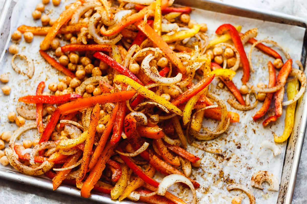 bell peppers and onions and chickpeas on a tray