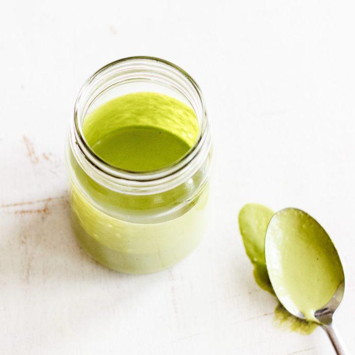 vegan green goddess sauce in a jar