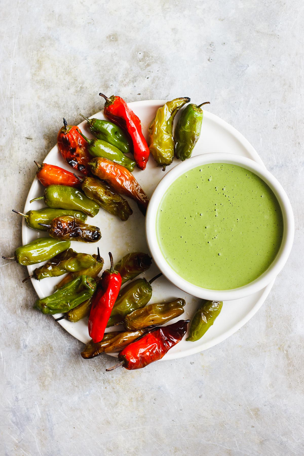 BLISTERED SHISHITO PEPPERS WITH CILANTRO LIME DIPPING SAUCE