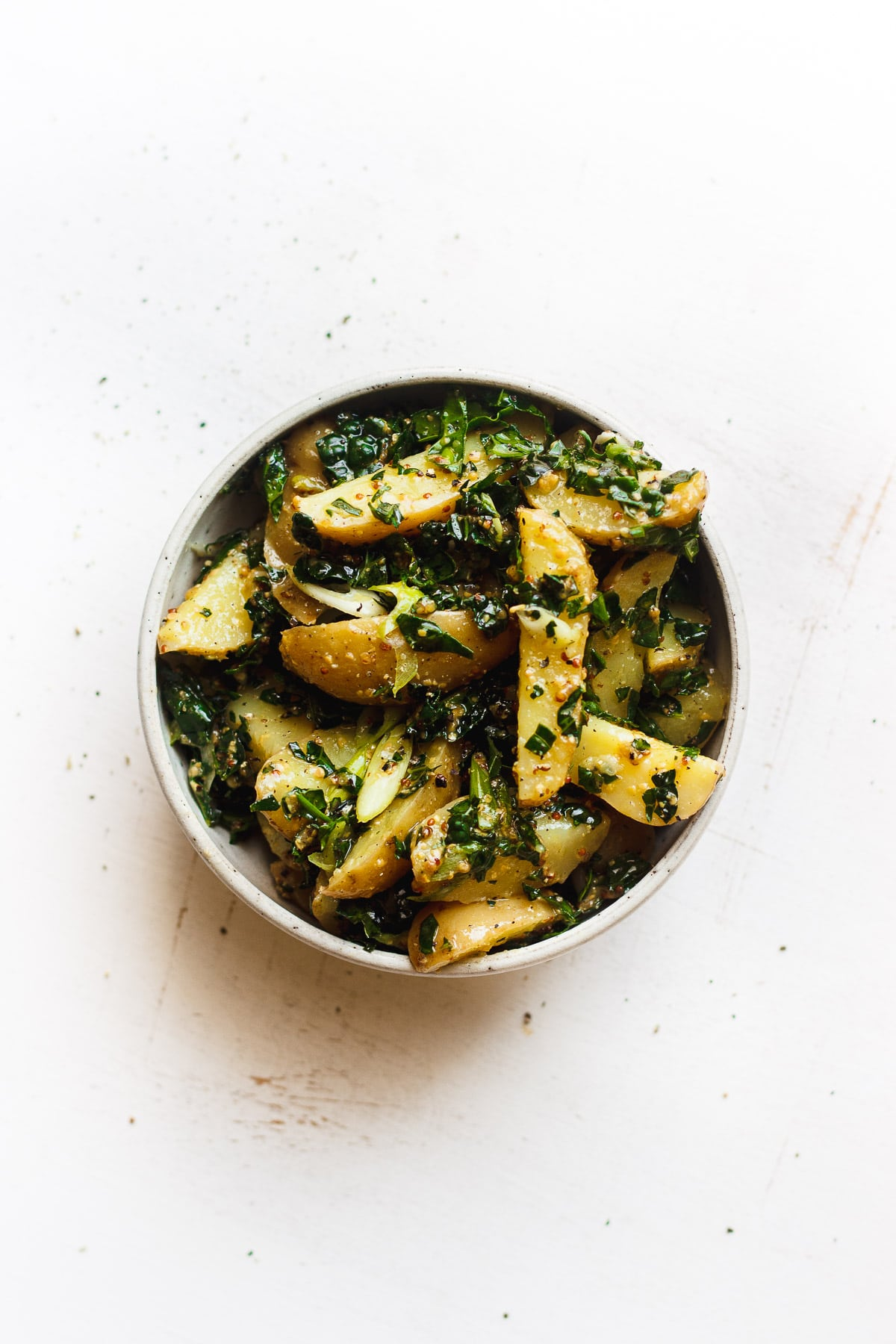kale potato salad with grainy mustard dressing in a bowl
