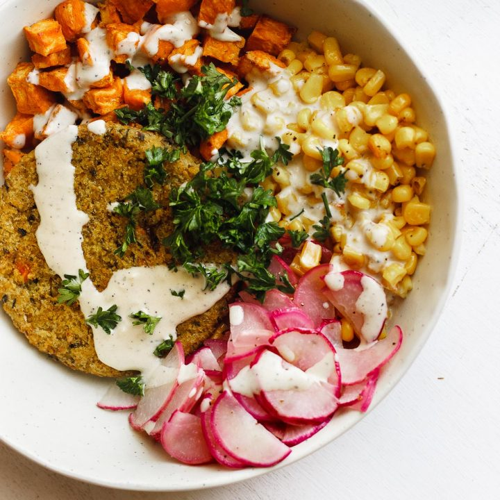 veggie burger bowl with corn and tahini