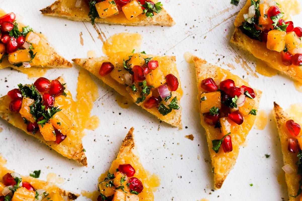 holiday toasts with pomegranate and herbs