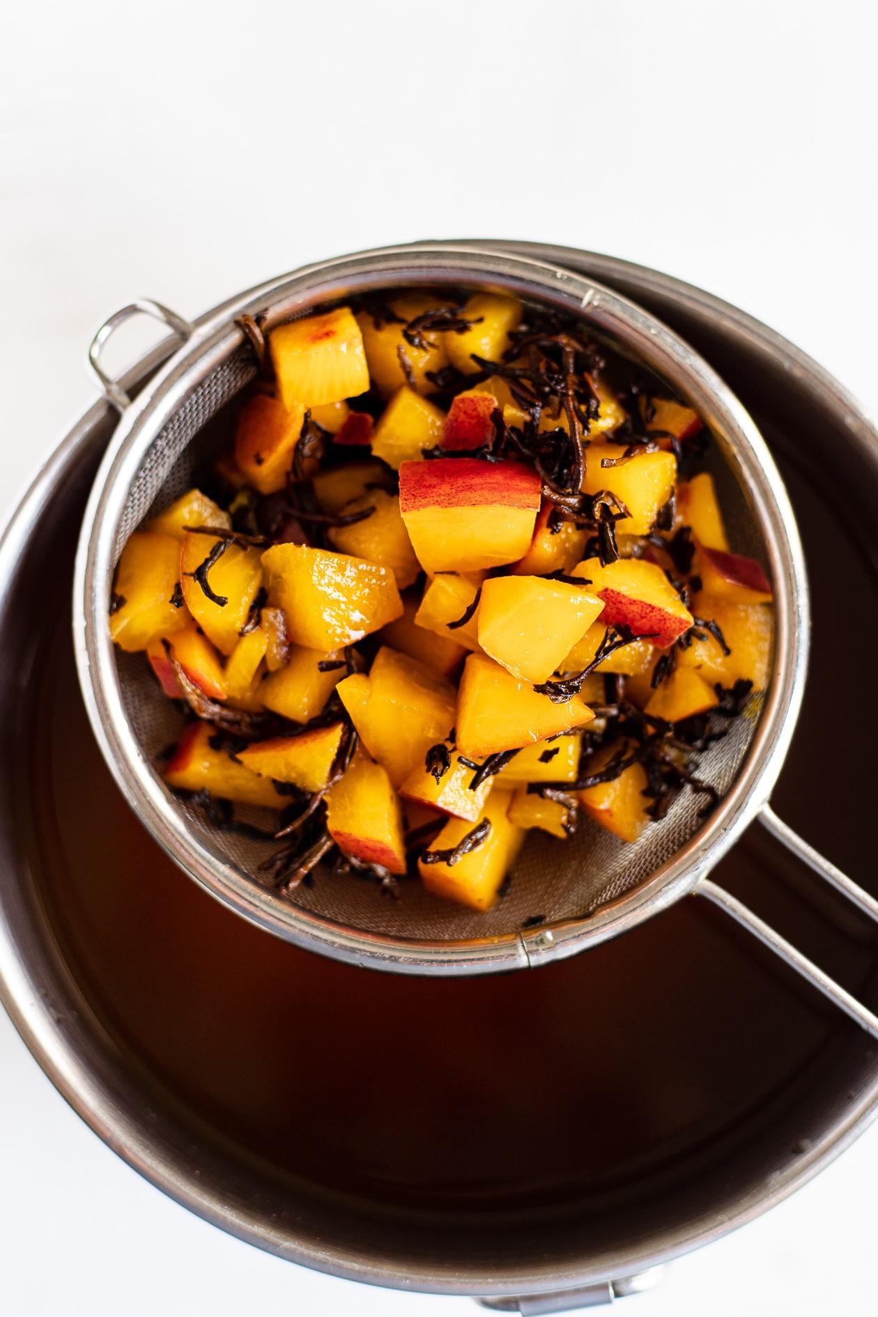 cold brew peach black tea in strainer
