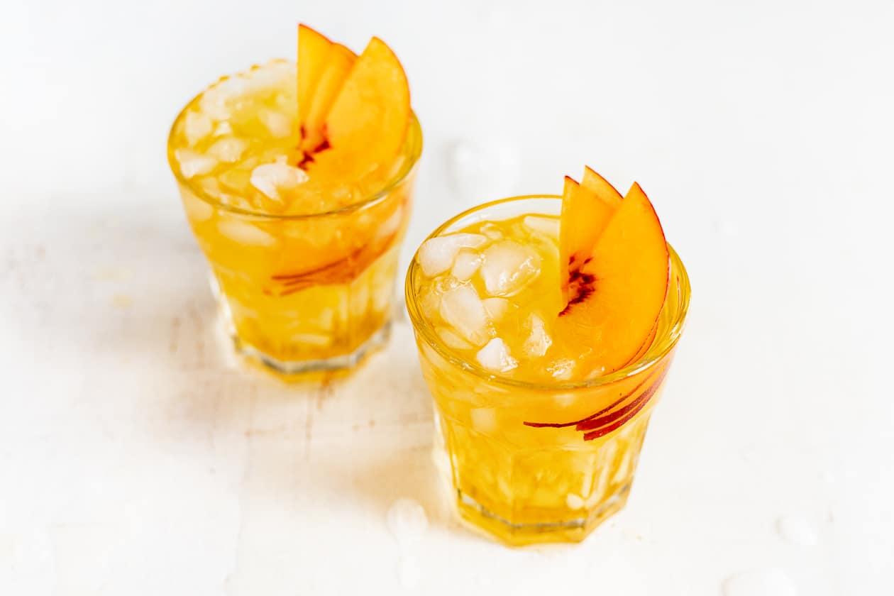 peach black tea spritzer in glasses