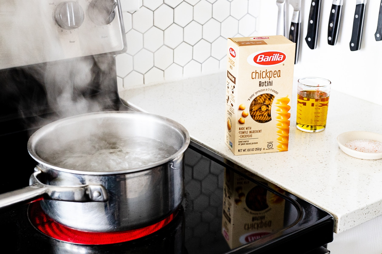 barilla pasta next to a pot of boil water